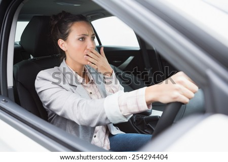 Nervous businesswoman crashing her car during her trip - stock photo