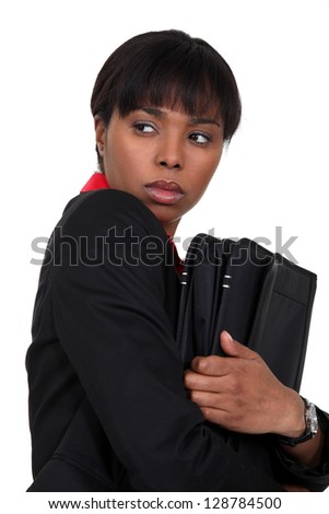 Nervous businesswoman has something to hide - stock photo