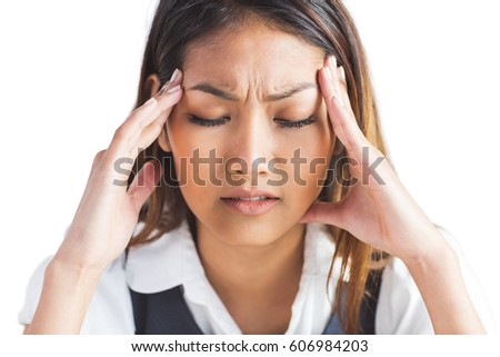 Nervous businesswoman holding her head on white background