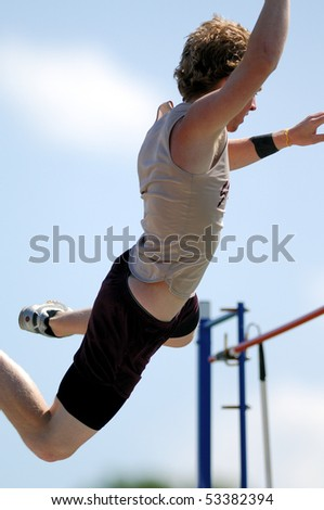 NESHAMINY PA - MAY 8: A St. Joe's Prep pole vaulter clears the bar and heads back down to earth during the Neshminy Invitational Meet on May 8, 2010 in Neshaminy, PA - stock photo