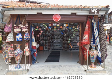 NESSEBAR, BULGARIA, JUNY 18, 2016: tourists visit the souvenir shops in the streets of the old town of Nessebar.