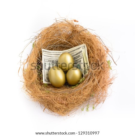 Nest egg with three golden eggs on US dollars