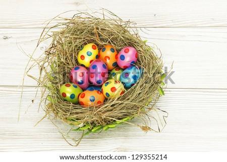 Nest full of colorful Easter Eggs - stock photo