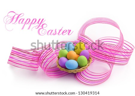 nest of colored easter eggs with pink ribbon