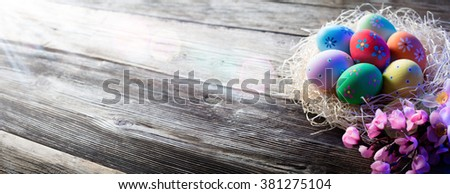 Nest Of Decorated Eggs On Wood - Easter Holiday Background  - stock photo