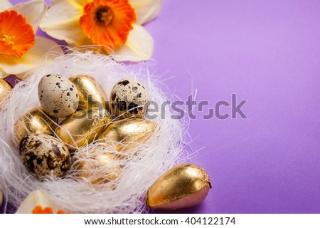 nest with eggs and daffodils on a blue background, easter