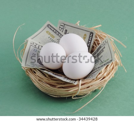 "Nest with money ($20 dollar bills) and eggs. Can symbolize a variety of things dealing with the economy and/or stock market such as ""nest egg"" and the term ""don't put all your eggs in one basket"""
