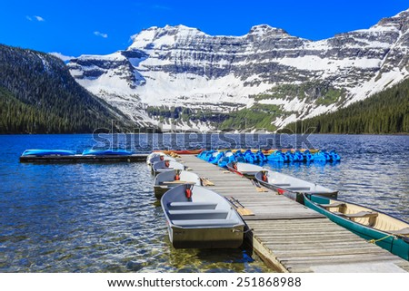 Nestled in a glacial basin, Cameron Lake is a hidden jewel high in the Canadian Rockies. Part of Waterton Lakes National Park, Cameron Lake offers fishing, boating and breathtaking views. - stock photo