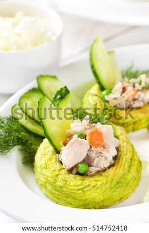 Nests made with duchess potatoes and peas stuffed with white fish ragout
