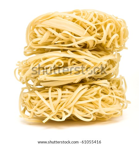 Nests of dried noodles from low perspective isolated on white.
