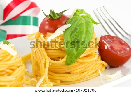 nests of spaghetti with tomato, basil and parmesan