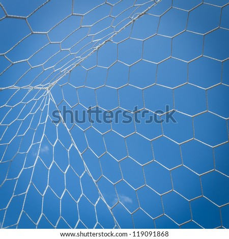 Net of soccer goal attach with blue sky