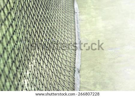 net on green  court sport background - stock photo