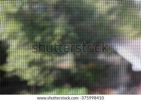 net on the window. - stock photo