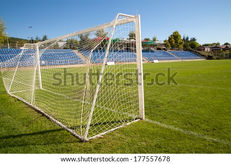 Net soccer goal football green grass - stock photo