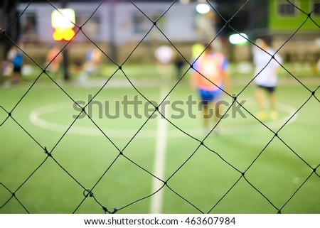 Net with Blurry Artificial turf football field background at night