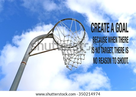 Netball goal ring and net against a blue sky and clouds with inspirational quote - stock photo