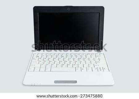 Netbook with white keyboard and black screen isolated on the white background. With cyrillic letters. - stock photo