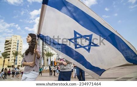 NETHANIA, ISRAEL - NOVEMBER 28, 2014 BNEI AKIVA youth group ceremony rehearsal with Israeli flags - stock photo