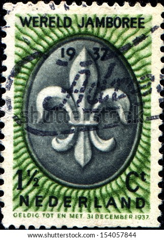 NETHERLAND - CIRCA 1937: A stamp printed in Netherland devotaed Scout Jamboree shows Scout Tenderfoot Badge, circa 1937  - stock photo