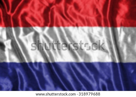 netherland flag,abstract blurred background - stock photo