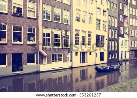 NETHERLANDS. AMSTERDAM - JUNE 23, 2015: A man sailing a boat trip on the picturesque city canal.