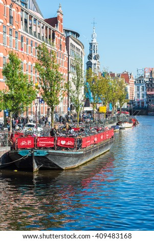 NETHERLANDS, AMSTERDAM - OCTOBER 2: bicycle parking on an old tour boat in Amsterdam on October 2, 2015 - stock photo