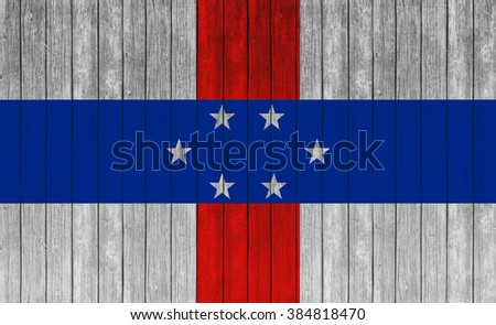 Netherlands Antilles flag on old wood texture background - stock photo
