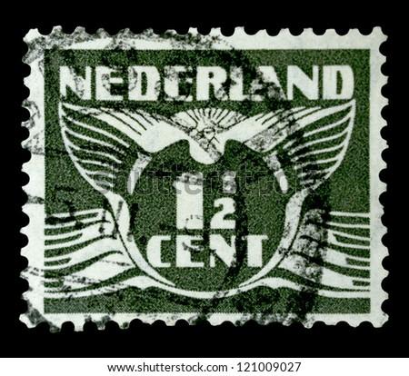 "NETHERLANDS - CIRCA 1935: A stamp printed in Netherlands, shows the value of a postage stamp and image of a Flying dove, without inscription, from the series ""Flying dove"", circa 1935"