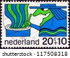 """NETHERLANDS - CIRCA 1968: A stamp printed in the Netherlands from the """"Child Welfare"""" issue shows a Witch, circa 1968. - stock photo"""
