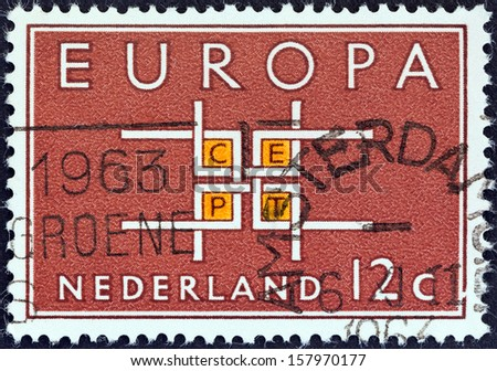 "NETHERLANDS - CIRCA 1963: A stamp printed in the Netherlands from the ""Europa"" issue shows Co-operation, circa 1963."