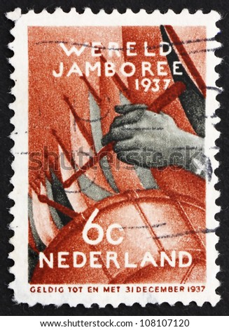 NETHERLANDS - CIRCA 1937: a stamp printed in the Netherlands shows Assembly of the Boy Scouts, Fifth Boy Scout World Jamboree, Vogelenzang, Netherlands, circa 1937 - stock photo