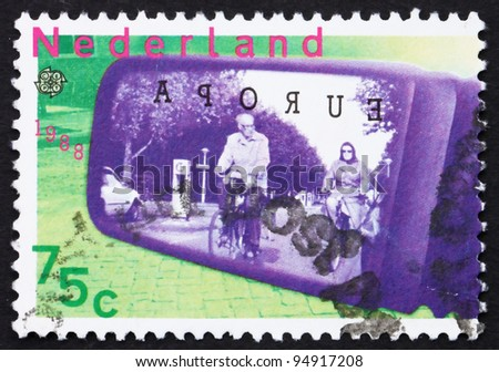 NETHERLANDS - CIRCA 1988: a stamp printed in the Netherlands shows Cyclists seen through car-door mirror, ecological transportation, circa 1988