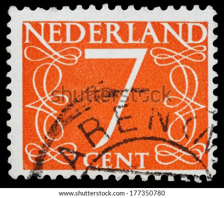 NETHERLANDS - CIRCA 1946: A stamp printed in the Netherlands shows it's value of 7 cent, circa 1946.  - stock photo