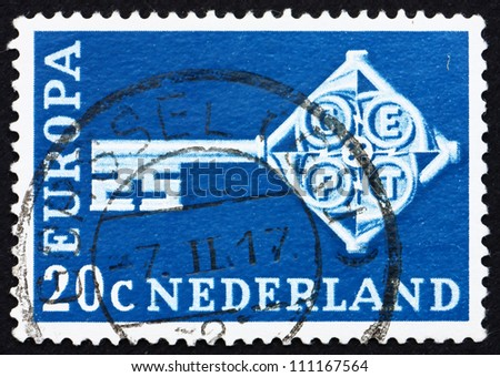 NETHERLANDS - CIRCA 1968: a stamp printed in the Netherlands shows Key with CEPT Emblem, Symbolizing Unity, European Community, circa 1968 - stock photo
