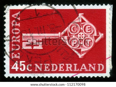 NETHERLANDS - CIRCA 1968: a stamp printed in the Netherlands shows Key with CEPT Emblem, Symbolizing Unity, European Community, circa 1968