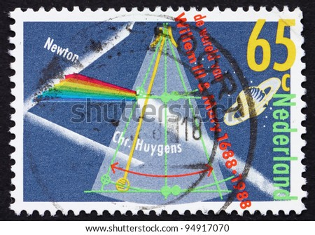 NETHERLANDS - CIRCA 1988: a stamp printed in the Netherlands shows Prism Splitting Light, Planet Saturn, Pendulum Clock, circa 1988
