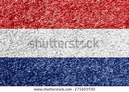 Netherlands flag on grass background texture - stock photo