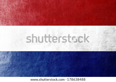 Netherlands Flag painted on leather texture - stock photo