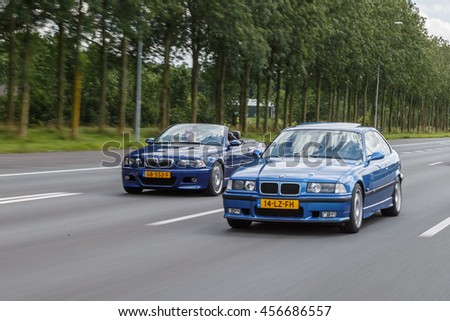 Netherlands June 17, 2016 BMW e36 M3 and e46 M3 driving on the highway at Holland