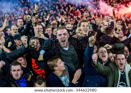 NETHERLANDS, ROTTERDAM - October 28th 2015: at the De Kuip stadium during the KNVB Beker match Feyenoord against Ajax ,  Enthusiastic fans party the victory of their football club