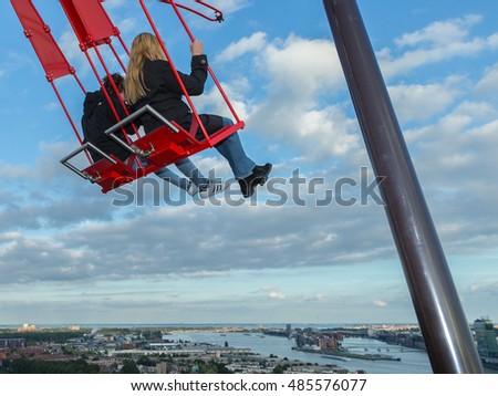 Netherlands 18 September 2016, over the edge, view on the capital city Amsterdam from a swing standing on a high building