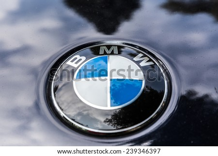 NETHERLANDS - SEPTEMBER 22, 2014: Parked BMW with recognisable round logo on September 22, 2014 in the Netherlands. The BMW logo evolved from the logo of aircraft engine manufacturer Rapp.