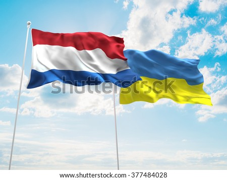 Netherlands & Ukraine Flags are waving in the sky - stock photo