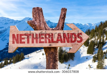 Netherlands wooden sign with winter background - stock photo