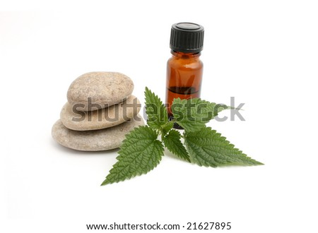 nettle and bottle isolated on white