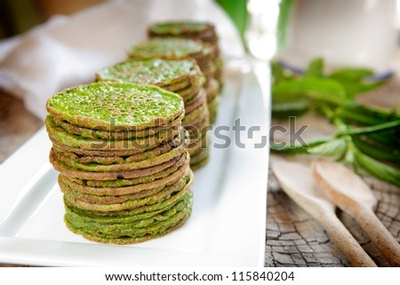 Nettle or spinach pancakes - stock photo