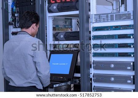 Network administrator working in data center