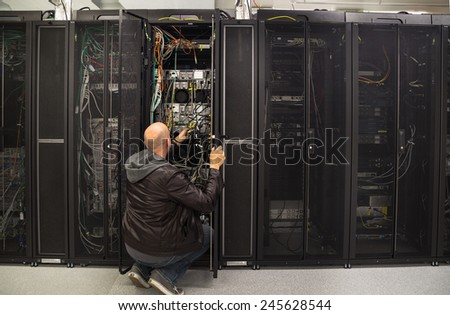 Network administrator working on some problem in a server room