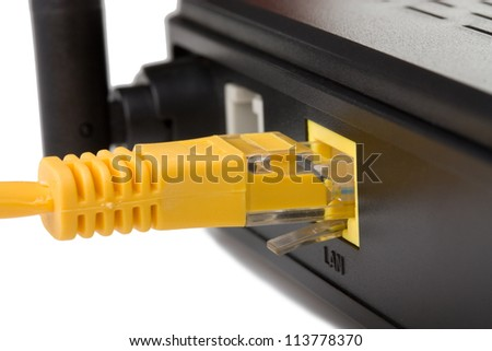 Network cable connected into a wireless router - stock photo